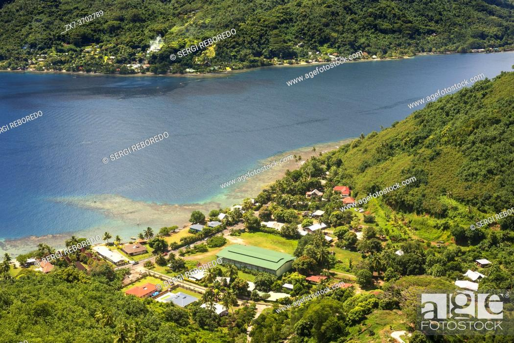 Stock Photo: Typical houses, road, and reef see, Moorea island (aerial view), Windward Islands, Society Islands, French Polynesia, Pacific Ocean.