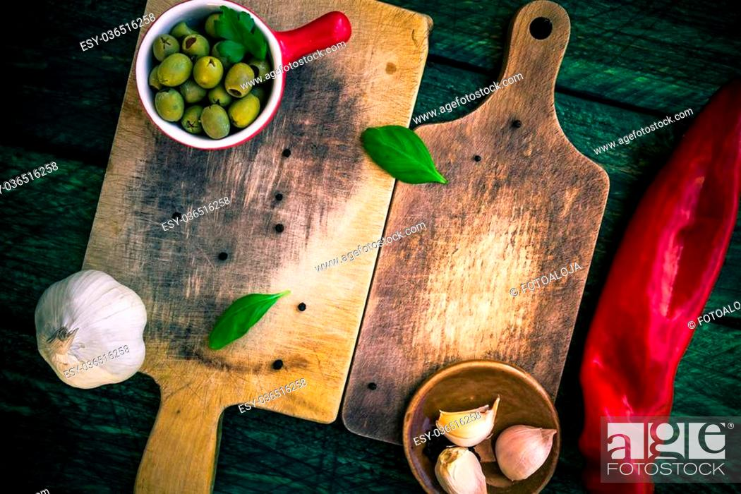 Stock Photo: Old chopping boards with spices and herbs.