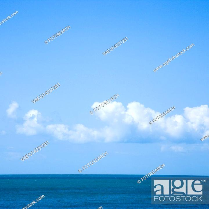 Stock Photo: Ocean and sky with low cumulus clouds.