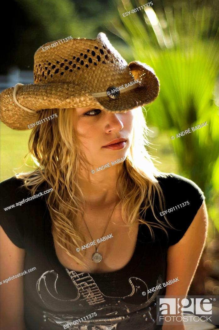Stock Photo: Sexy country girl with cowboy hat.