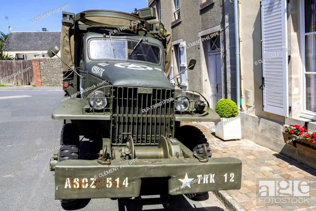 Stock Photo: WW2 U.S. Army GMC CCKW 2½-ton 6x6 cargo truck with winch and machine gun ring, used during the Normandy invasion.