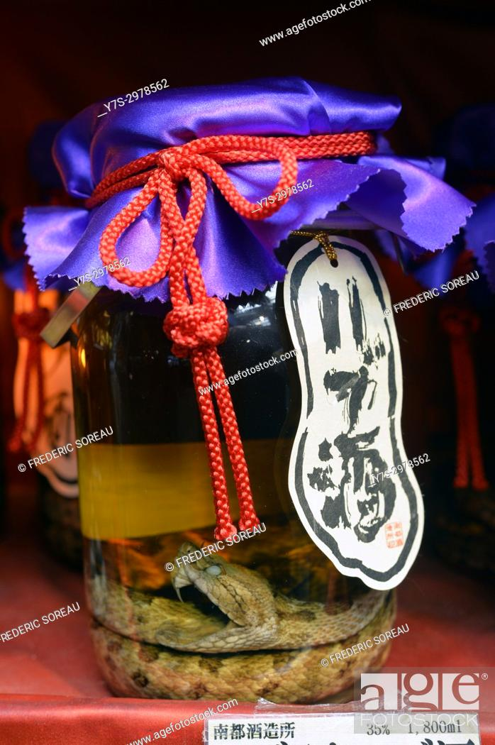 Stock Photo: Okinawan Snake Wine or Habushu on display in one of the many tourist souvenir shops on kokusai Dori , Naha, Okinawa island, Japan, Asia.