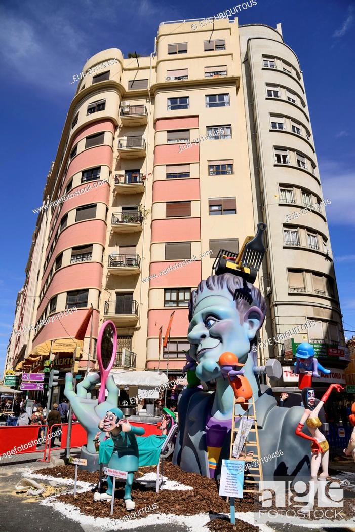 Stock Photo: Typical falla scene with papier mache figures in the street during Las Fallas festival.