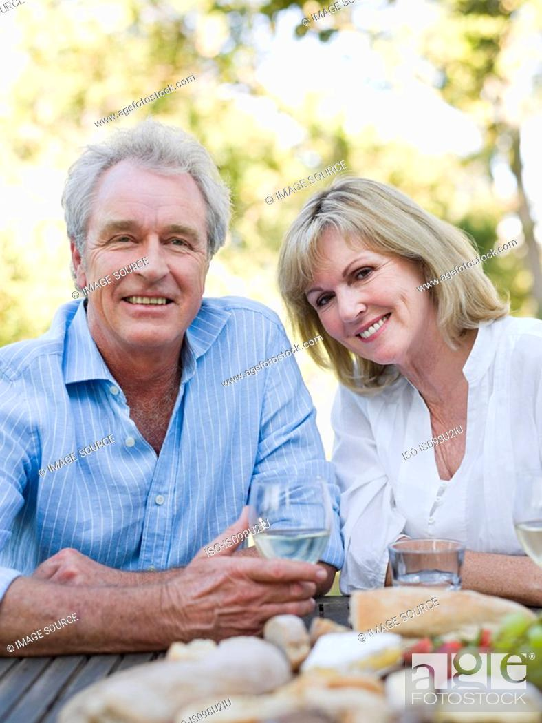 Stock Photo: Mature couple at meal outdoors.