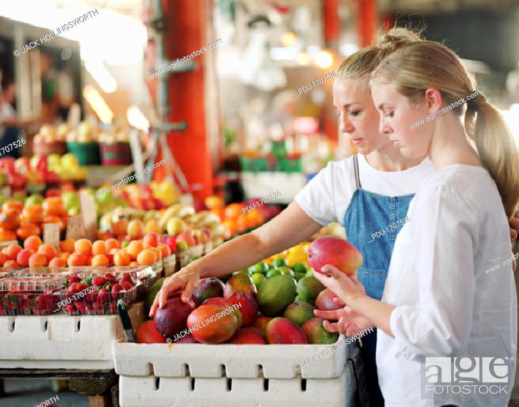 Stock Photo: mother and daughter at the market.