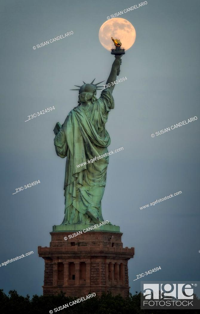 Stock Photo: Full Moon Statue Of Liberty.