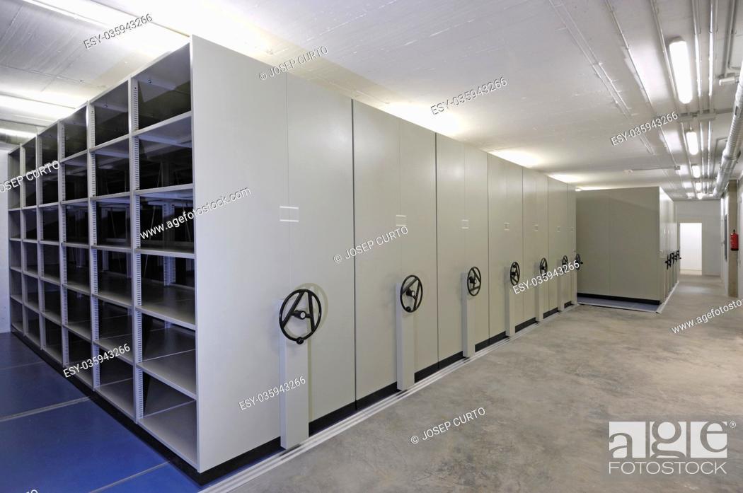 Stock Photo: empty warehouse with sliding doors, white color.
