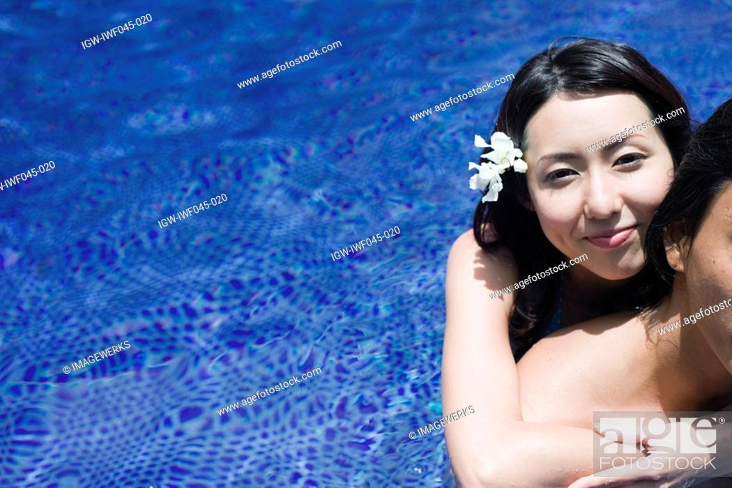 Stock Photo: A young couple in pool.