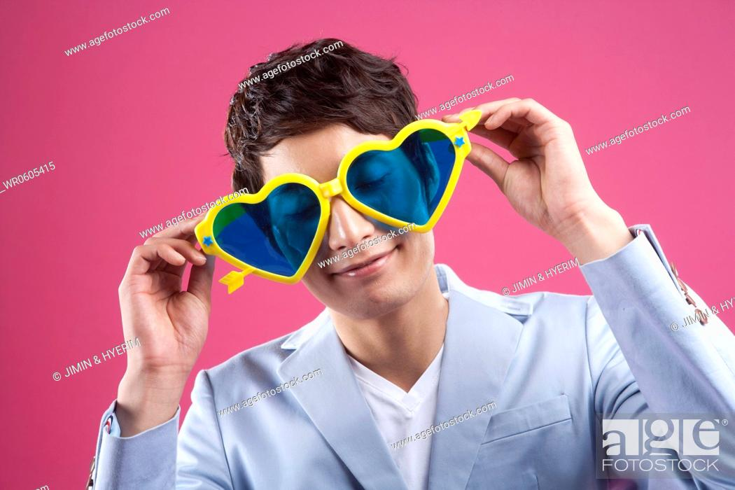 Stock Photo: A man wearing the heart shaped glasses.