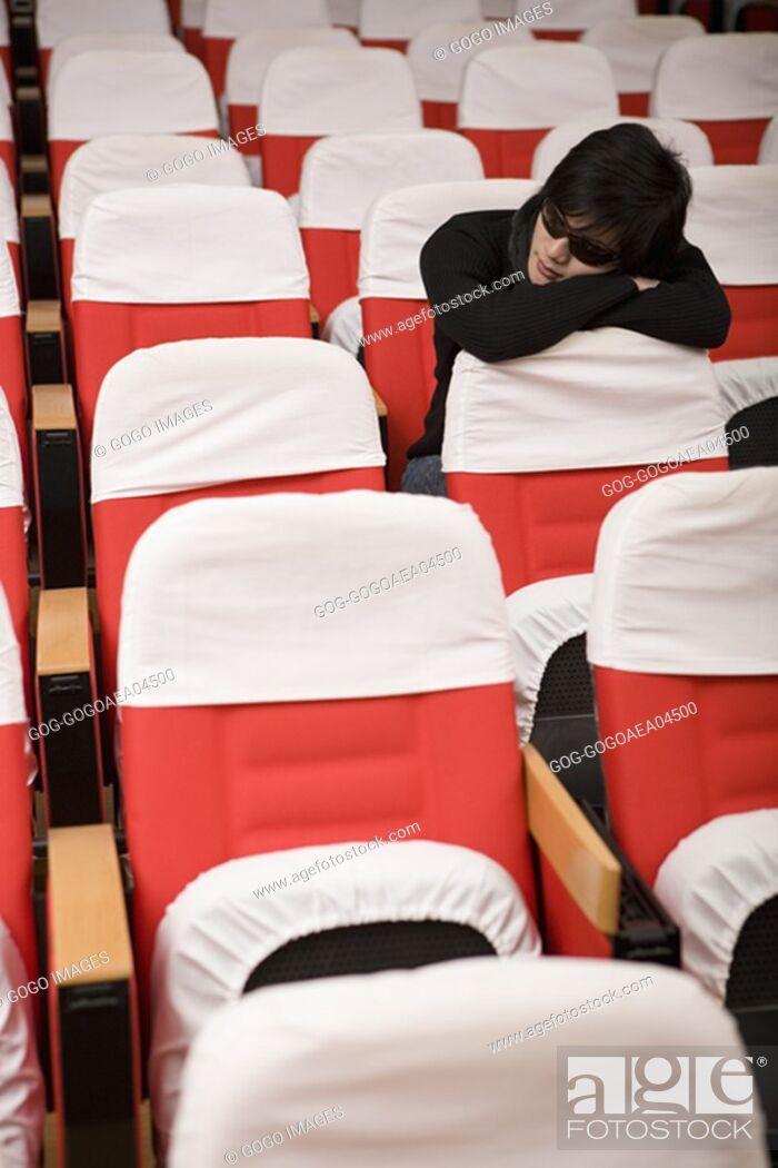 Stock Photo: Student sleeping in empty classroom.