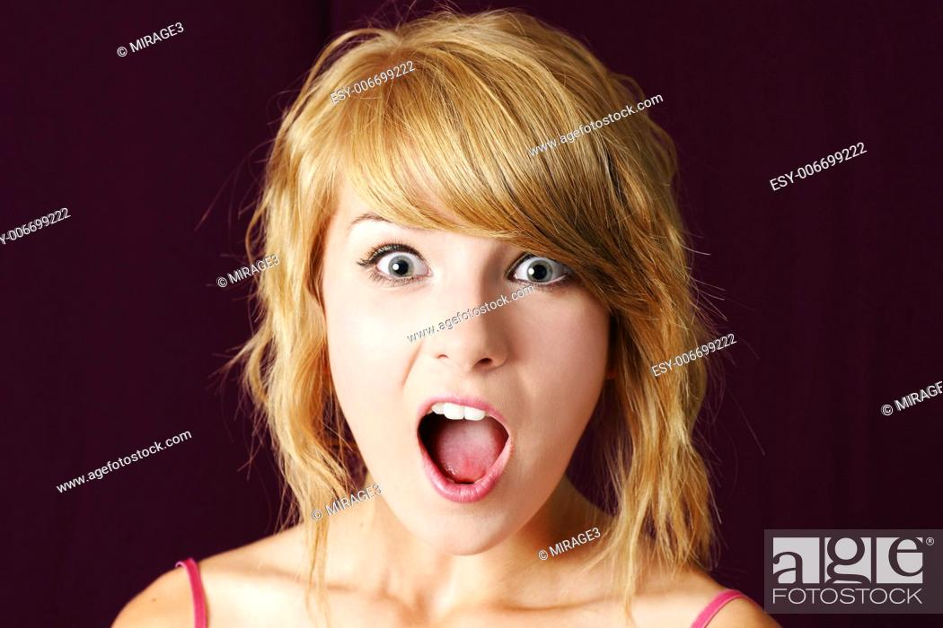 Stock Photo Very Surprised Or Shocked Young Blond Teenager Girl Making Funny Face With