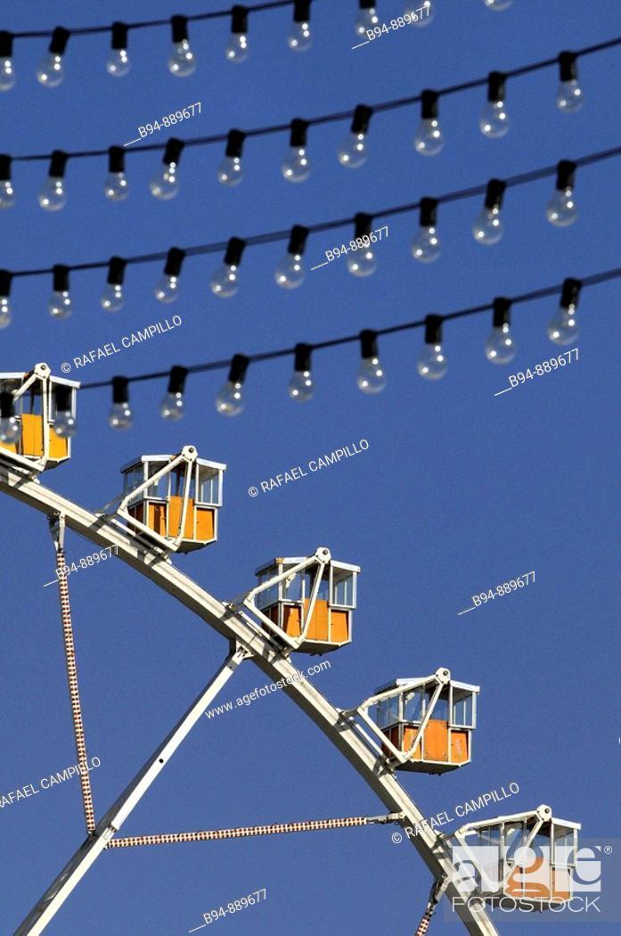 Stock Photo: Ferris wheel and light bulbs, April Fair, Barcelona. Catalonia, Spain.