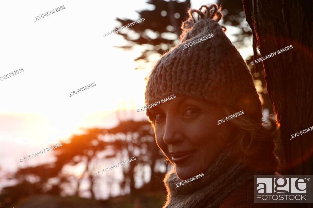 Stock Photo: Mature woman in a hat and scarf.