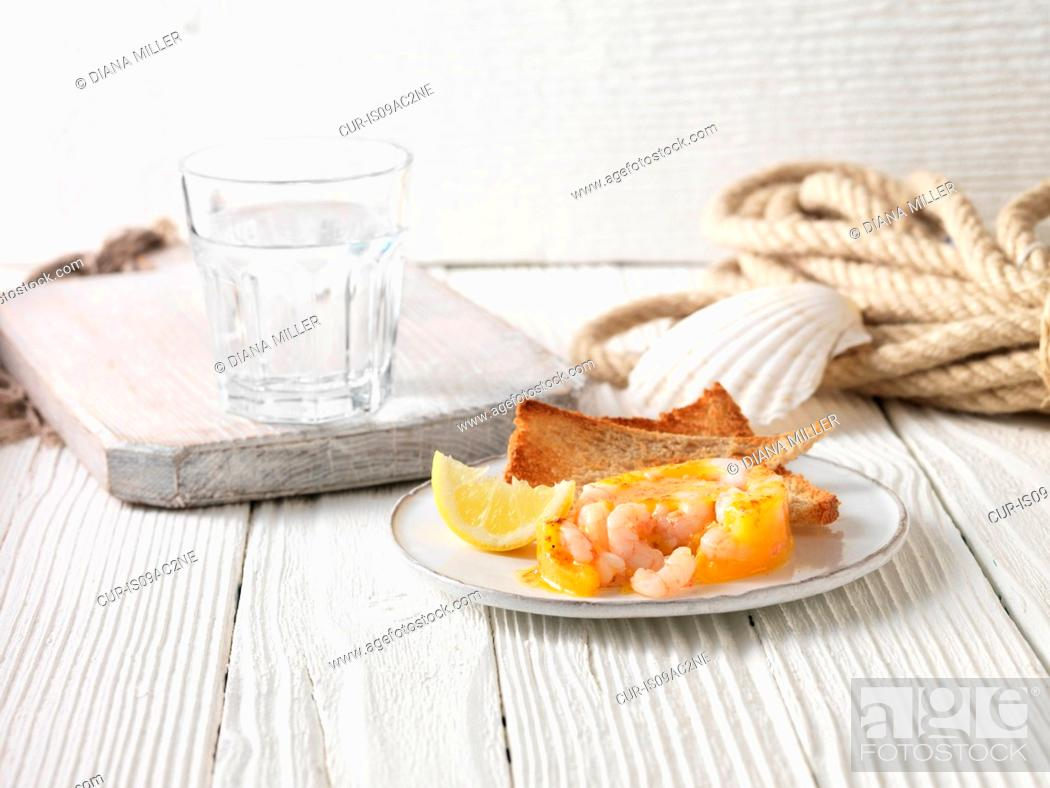 Stock Photo: Potted prawns with wholemeal toast and lemon.