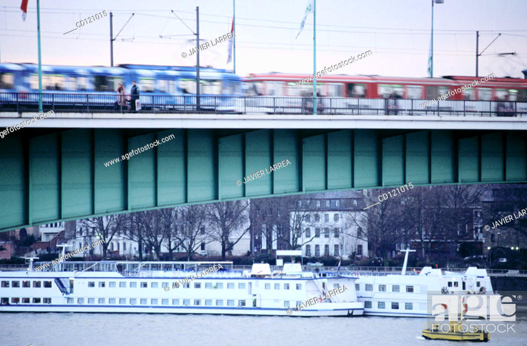 Stock Photo: Trams crossing Deutzer Bridge (Deutzer Rheinbrücke) at Rhine River. Cologne. Germany.
