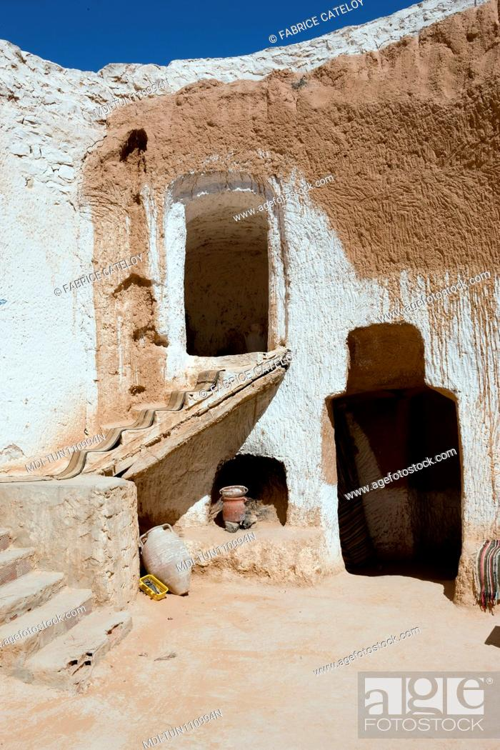 Stock Photo: Tunisia - Matmata - Stairs in the yard of the underground house Diar Amor.