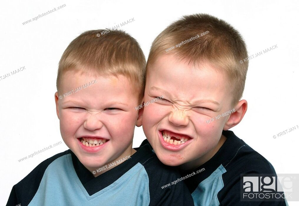 Stock Photo: Close-up of two boys clenching their teeth.