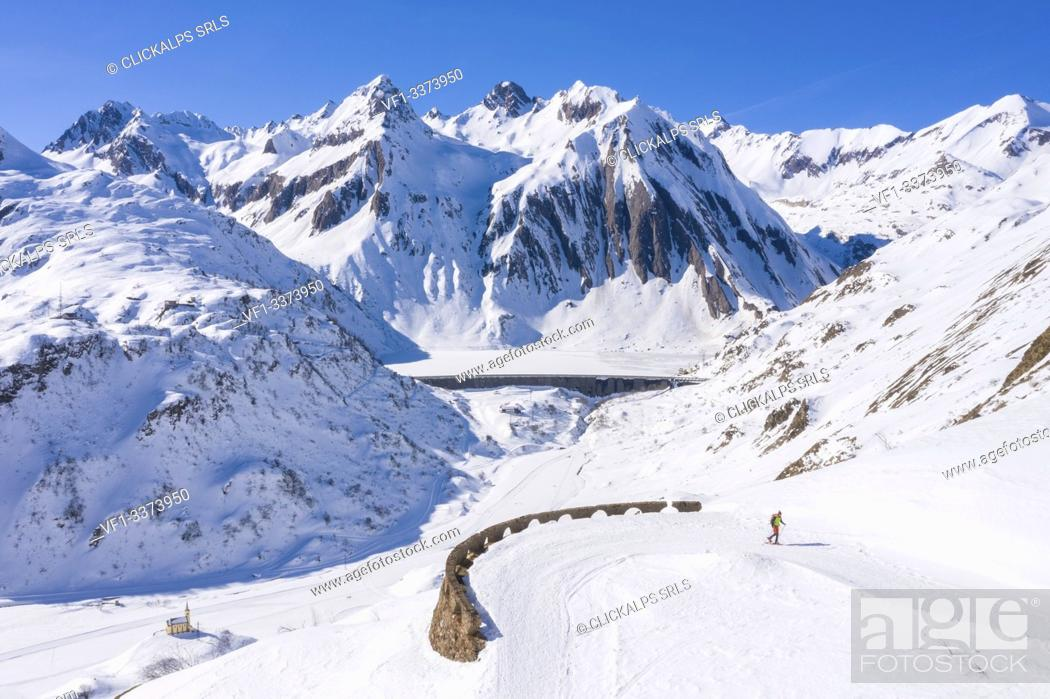 Imagen: Trekker with snowshoes in Riale, Formazza Valley, Verbano Cusio Ossola Province, Piedmont, Italy, Europe.