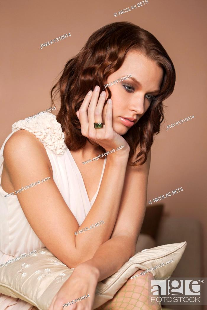 Stock Photo: Young woman day dreaming.