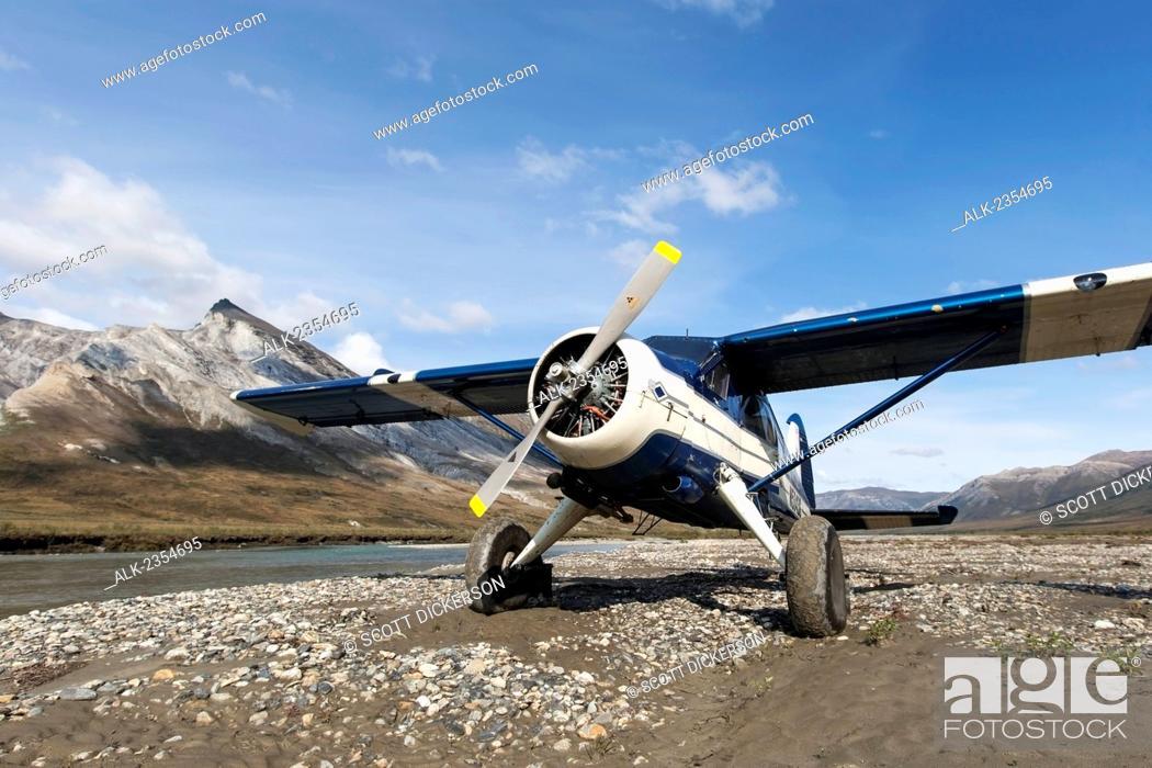 Stock Photo: Bushplane arriving at the Noatak River, Brooks Range, Arctic Alaska; Alaska, United States of America.
