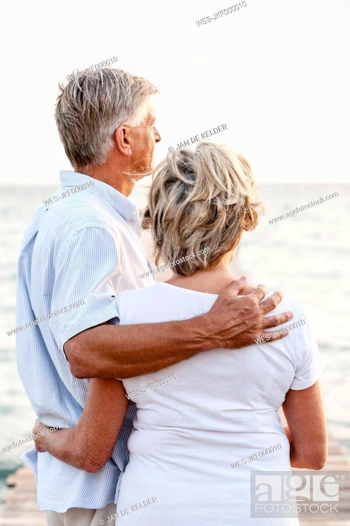 Stock Photo: Spain, Senior couple standing at the sea.