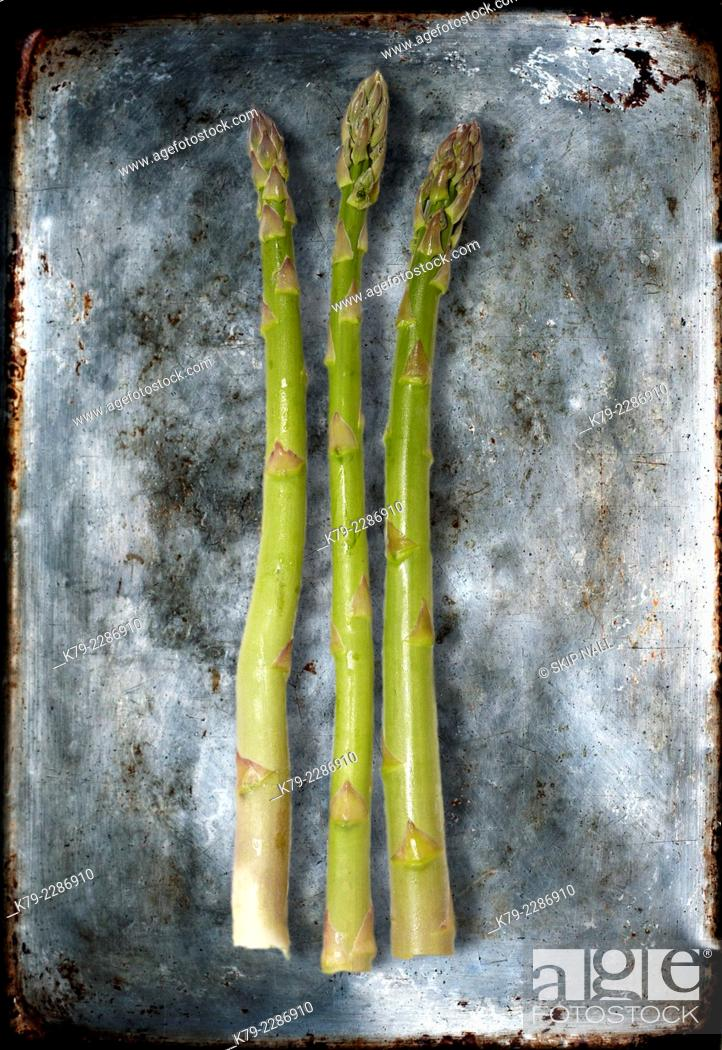 Stock Photo: Sill life of three pieces of asparagus.