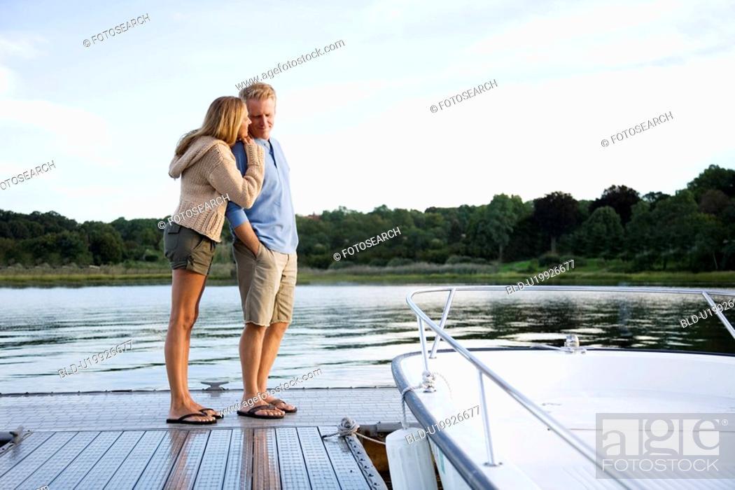 Stock Photo: Couple standing on pier.