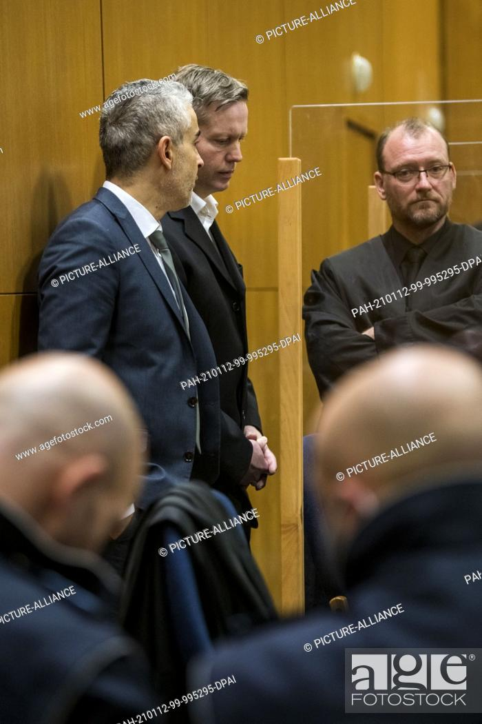 Stock Photo: 12 January 2021, Hessen, Frankfurt/Main: Main defendant Stephan Ernst (back, M) stands between his lawyers Mustafa Kaplan (back, l) and Jörg Hardies (back.