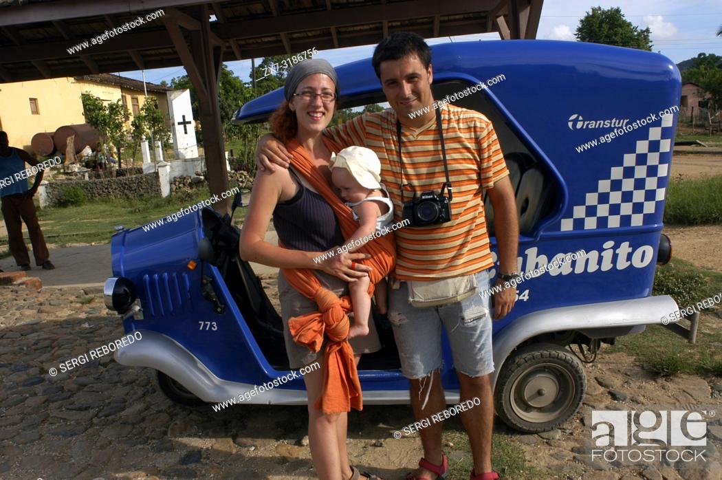 Stock Photo: Caucasian family of tourist in a Cubanito, typical tuc-tuc transport in Trinidad, Cuba.