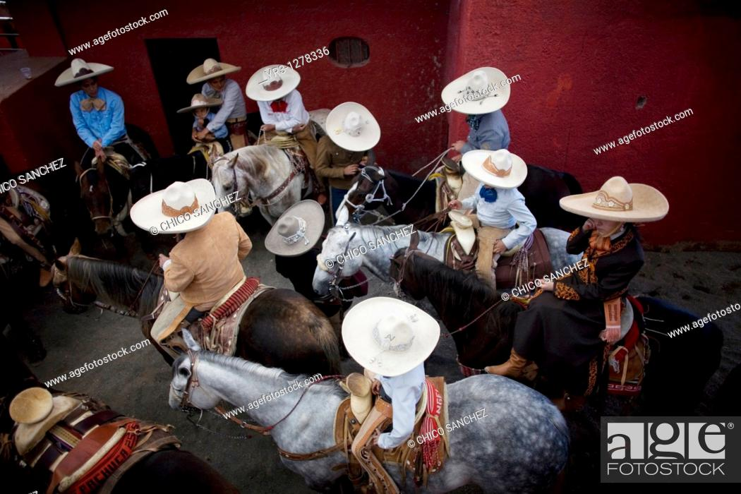 Stock Photo: Mexican charros attend at the National Charro Championship in Pachuca, Hidalgo State, Mexico. Escaramuzas are similar to US rodeos.