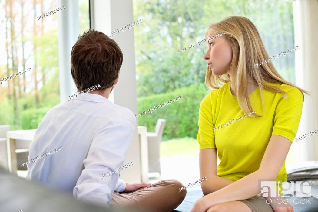 Stock Photo: Couple sitting serious, man ignoring girlfriend.