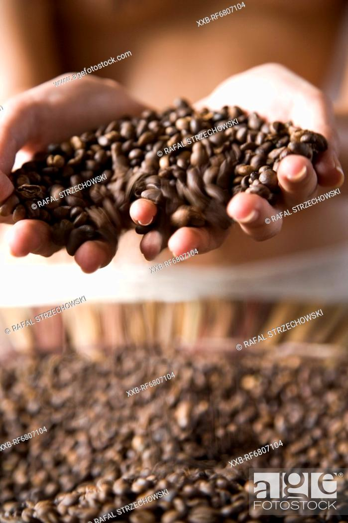 Stock Photo: Woman with coffee grains.
