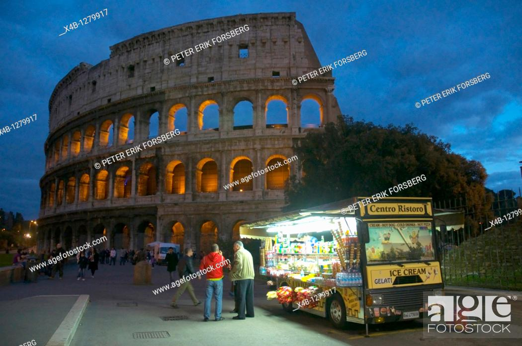 Stock Photo: Drink and sweet stall outside Colousseum at dusk central Rome Italy Europe.
