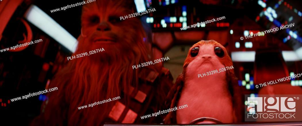 """Stock Photo: L to R: Chewbacca (Joonas Suotamo) and a Porg, """"""""Star Wars: The Last Jedi"""""""" (2017) Lucasfilm Ltd."""