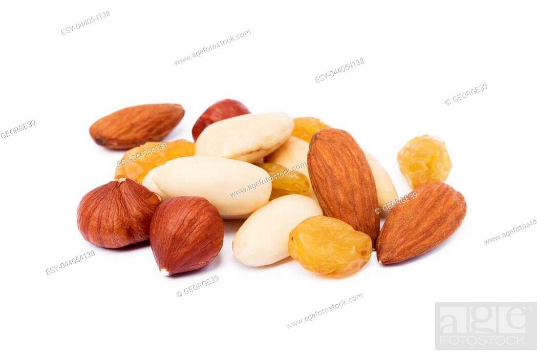 Stock Photo: Mixed fresh nuts and raisins isolated on white background.