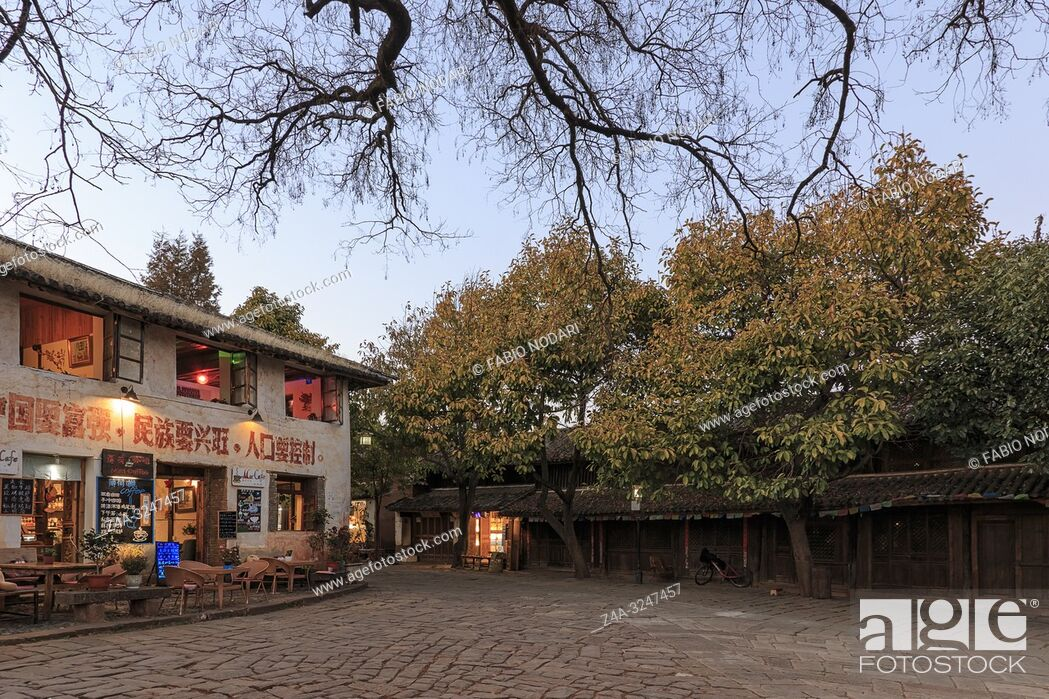 Stock Photo: Shaxi, China - February 21, 2019: Central square of Shaxi old town at sunset.