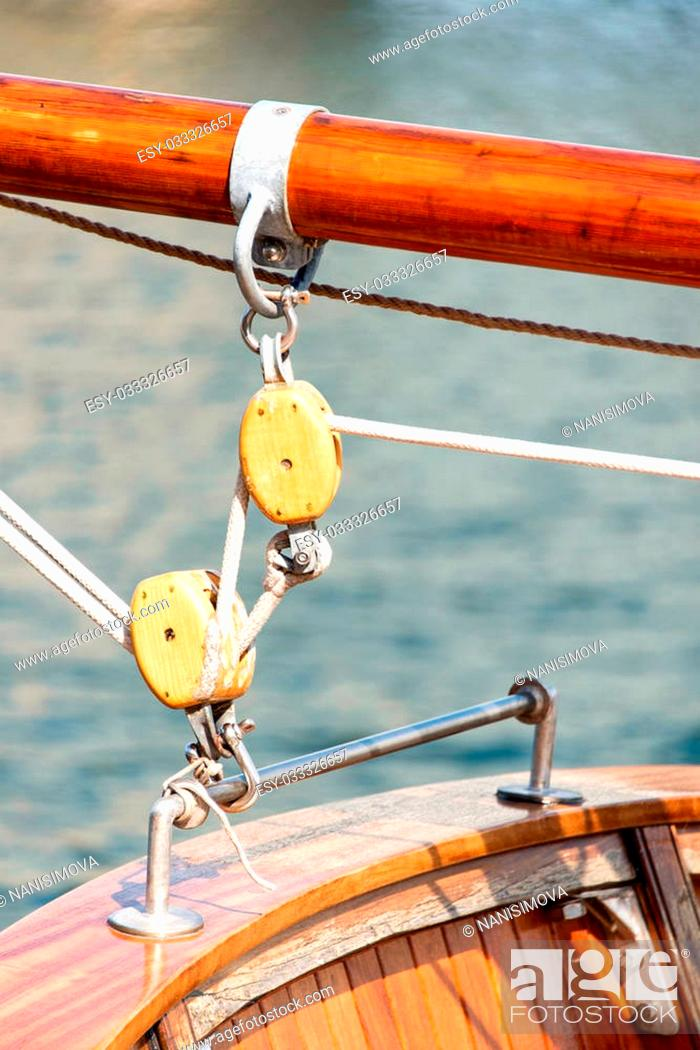 Stock Photo: Wooden block with rope. block and tackle.