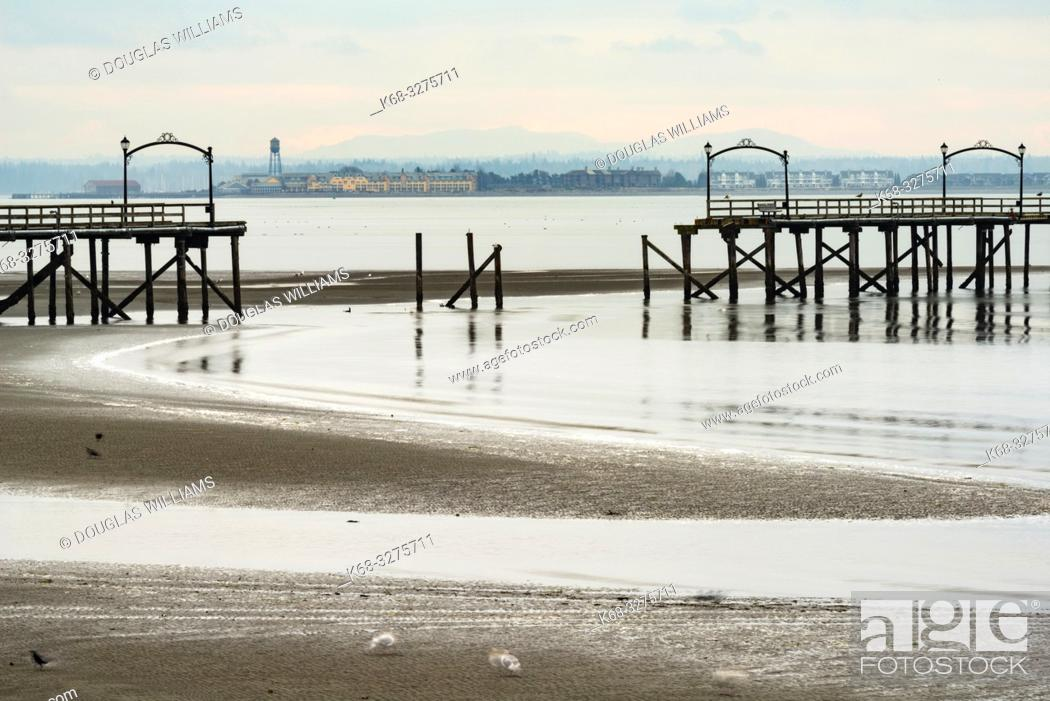 Stock Photo: View from White Rock, of the White Rock pier, damaged in a storm, British Columbia, Canada.