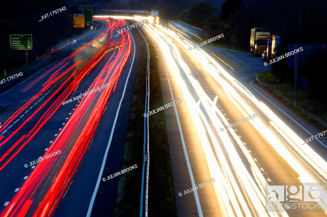 Stock Photo: traffic leaving light trails at night on a main road.
