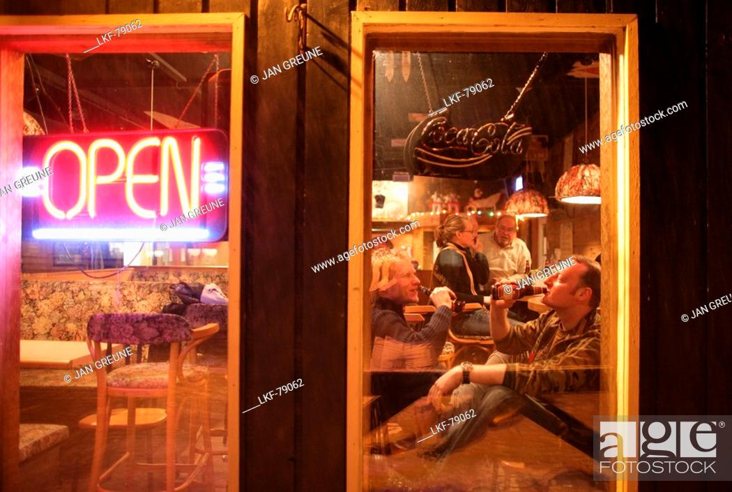 Stock Photo: People drinking beer in the T-Bar pub, Castle Mountain ski resort, Alberta, Canada.