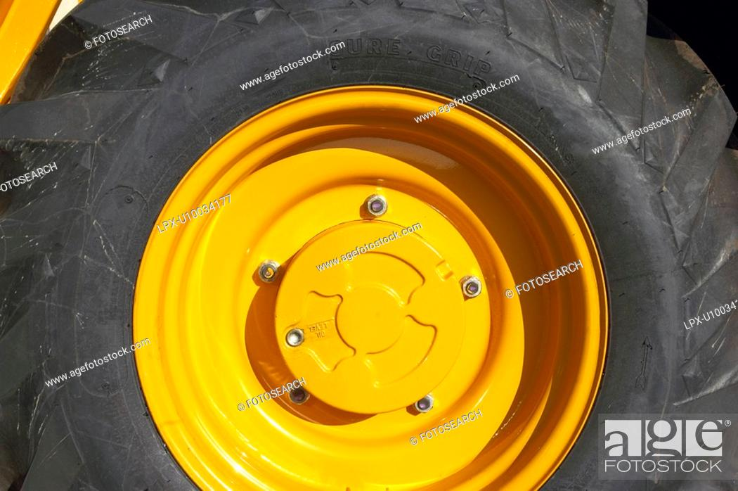 Stock Photo: Brand new wheel on a construction vehicle.