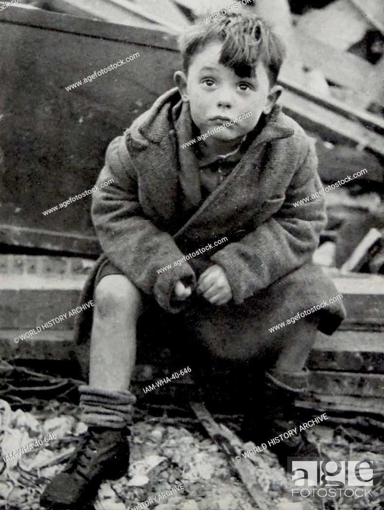 an orphaned child looks shocked after surviving the blitz on london