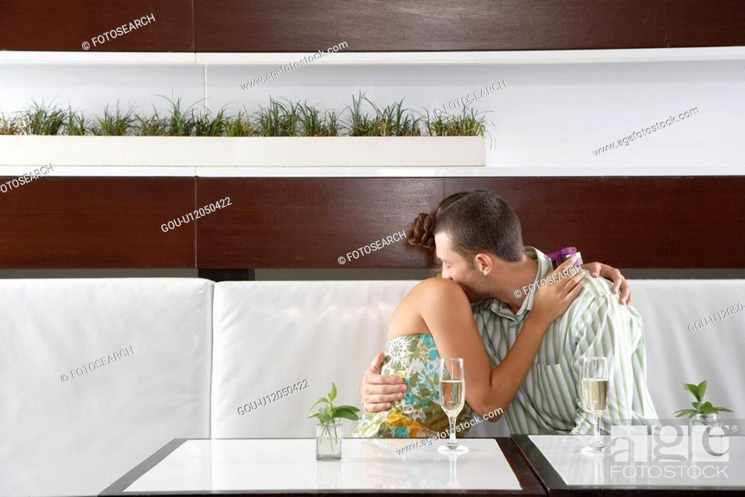Stock Photo: Woman with gift hugging man.