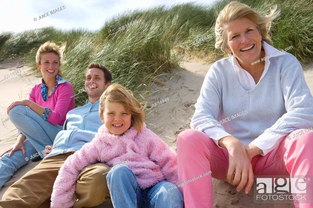 Stock Photo: Portrait of family relaxing on beach.