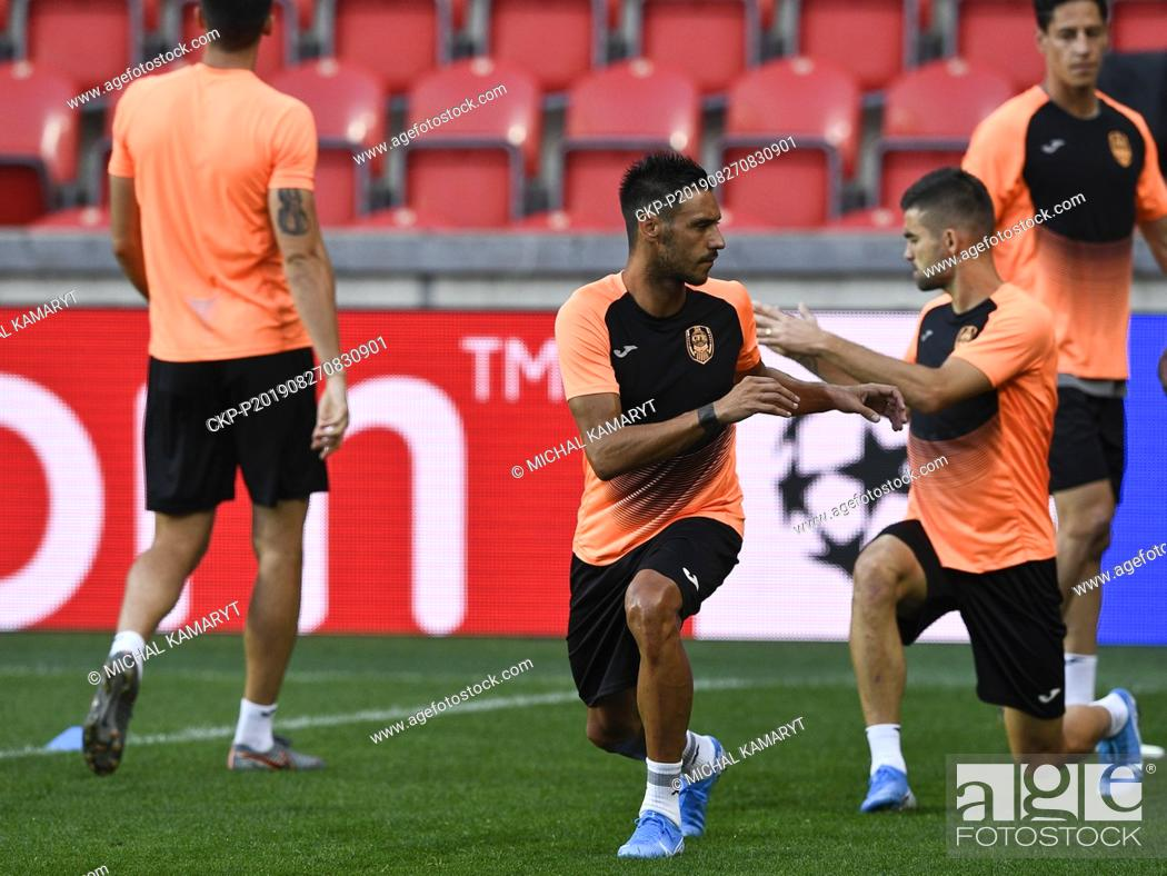 Stock Photo: Mario Camora, center, attends a training session of CFR Cluj (Cluj-Napoca) team prior to the UEFA Champions League, 4th qualifying round return match: SK Slavia.