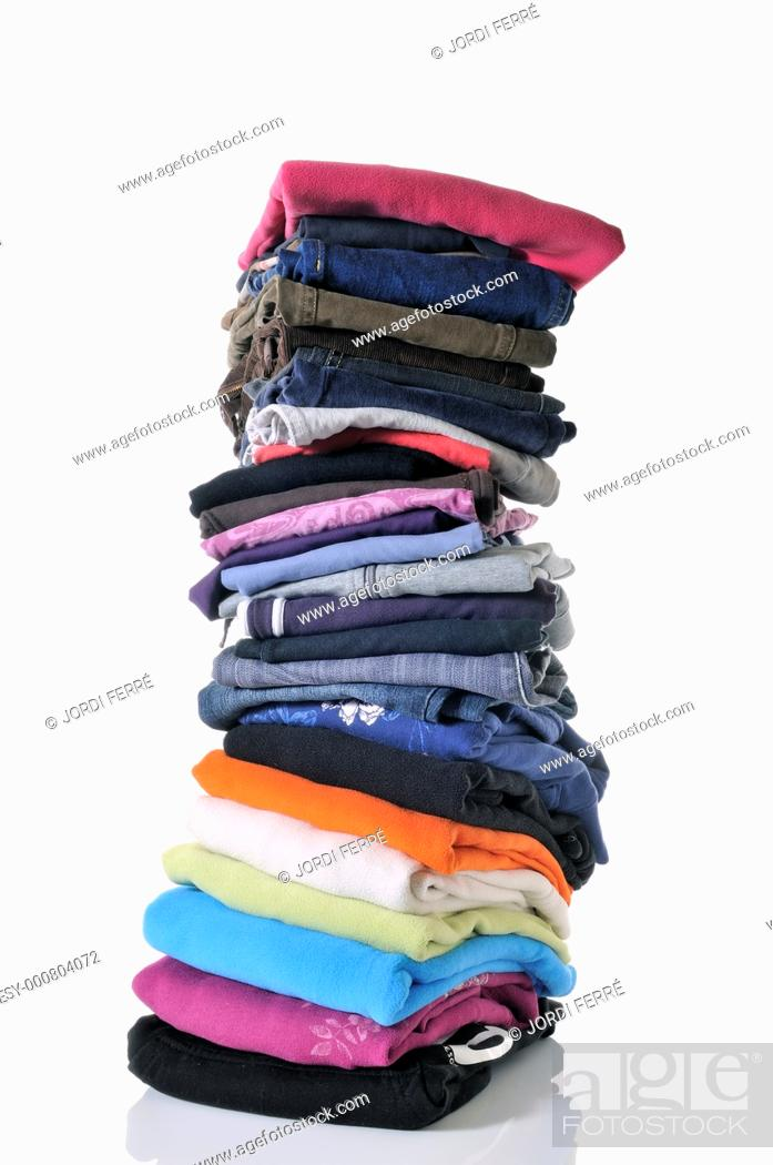 Imagen: pile of folded clothes on white background.