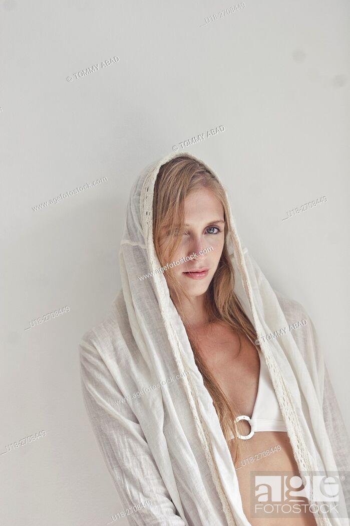 Imagen: blonde woman with white tunica and white bikini / white background.