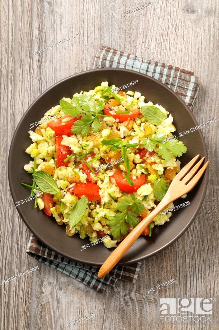 Stock Photo: Cauliflower tabouleh with tomatoes and mint.