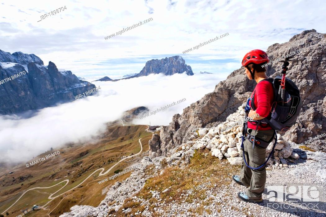 Stock Photo: Climber on the way up to Gran Cir mountain above the Gardena Pass, Dolomites, Val Gardena valley and Langkofel mountain at the back, province of Bolzano-Bozen.