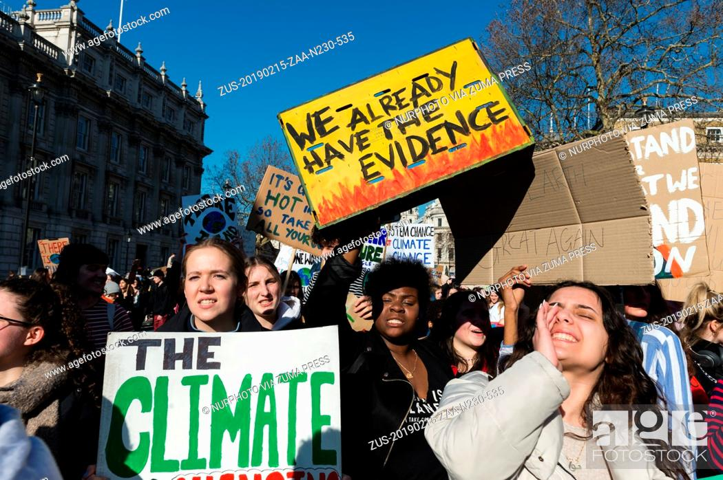 Stock Photo: February 15, 2019 - London, England, United Kingdom - Thousands of young people gather in central London to protest against the government's lack of action on.